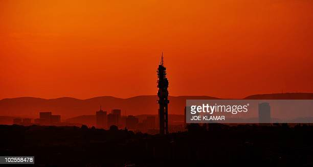 A picture shows the city skyline during the sunset in Pretoria on June 30 2010 AFP PHOTO/JOE KLAMAR