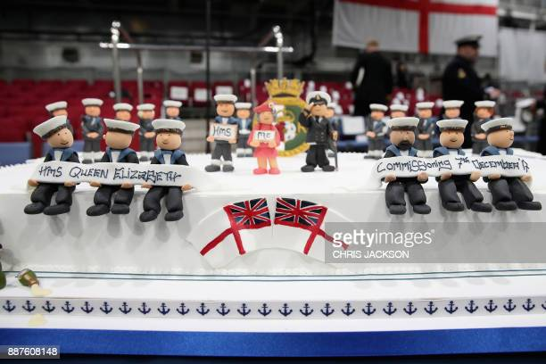 A picture shows the commissioning cake with figures and scenes on it made by David Duncan for the Commissioning Ceremony to be attended by Britain's...