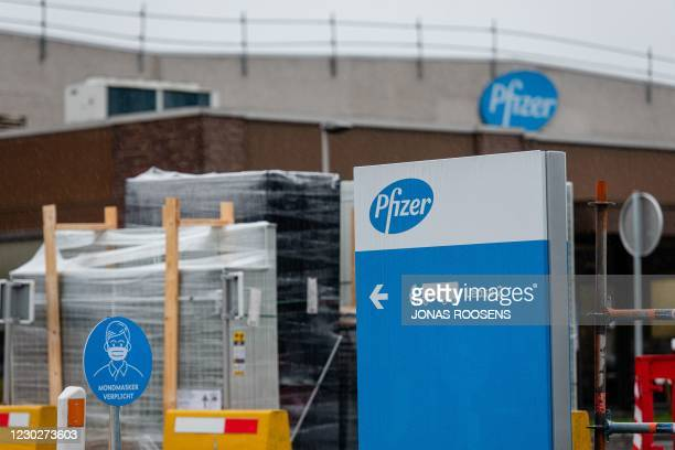 Picture shows the company logo at the US pharmaceutical giant Pfizer plant in Puurs, northeast Belgium, on December 23 on the day trucks carrying the...