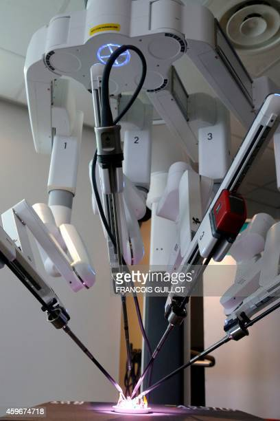 A picture shows the Da Vinci Xi surgical robot manipulating a model as it carries out a demonstration during its presentation on November 26 2014 at...