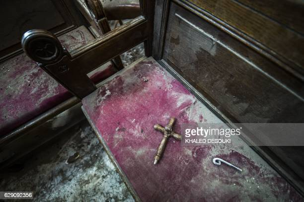 A picture shows the damage following a bomb explosion at the Saint Peter and Saint Paul Coptic Orthodox Church on December 11 in the Abbasiya...