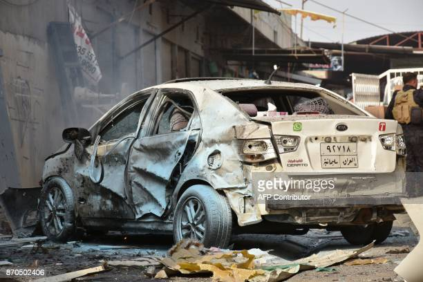 A picture shows the damage following a twin suicide attack at shopping area in Iraq's disputed Kirkuk city on November 5 2017 The attackers struck...