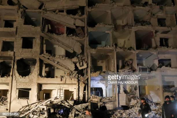 A picture shows the damage following an explosion at a base for Asian jihadists in a rebelheld area of the northwestern Syrian city of Idlib on...