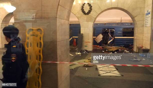 TOPSHOT A picture shows the damaged train carriage at Technological Institute metro station in Saint Petersburg on April 3 2017 Around 10 people were...