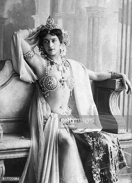 Picture shows the dancer and espionage agent Mata Hari posing on a wood chair in an elaborate costume Undated photo circa 1910s