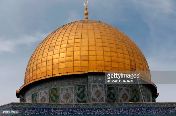 A picture shows the Dome of the Rock at the AlAqsa Mosque compound in Jerusalem during Friday prayers on October 23 2015 Earlier in the day Israel...