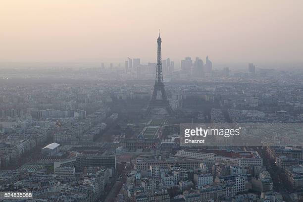 Picture shows the Eiffel tower and Paris' roofs through a haze of pollution on March 23, 2015 in Paris, France. The city of Paris is experiencing a...