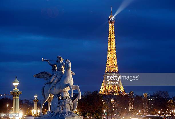A picture shows the Eiffel Tower by night on November 13 2015 in Paris France Paris will host the World Climate Change Conference 2015 from November...