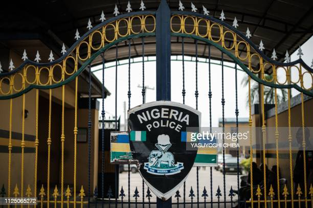 A picture shows the emblem of the Nigerian Police on the main gate at Rivers State Police headquaters in Port Harcourt southern Nigeria on February...