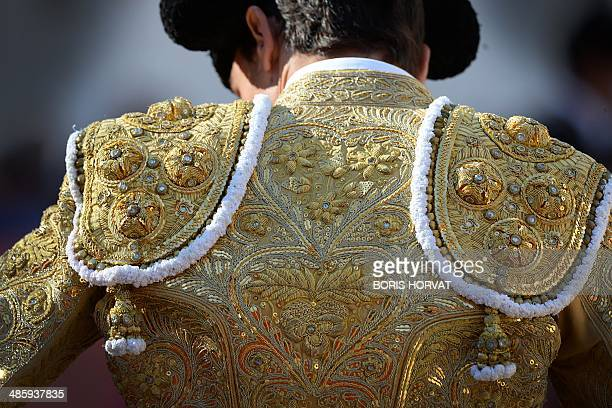 A picture shows the embroidery on the suit of light of Spanish matador Paco Urena on the last day of the Feria of Arles on April 21 2014 in Arles...