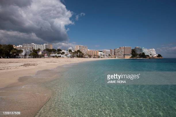 Picture shows the empty beach at Magaluf Beach tourist resort in Calvia on April 4 during a national lockdown to prevent the spread of the COVID19...