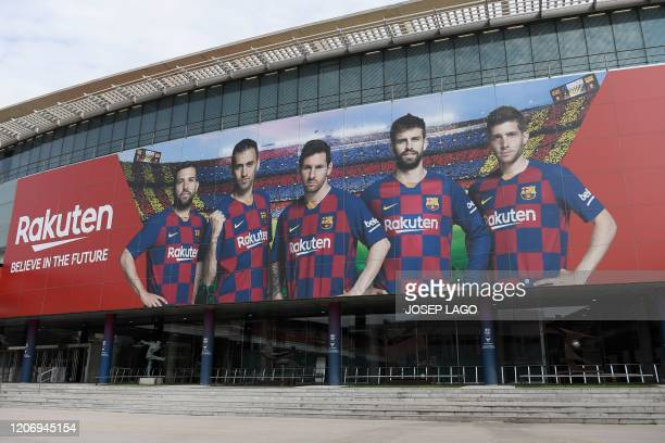 A picture shows the empty entrance to the Camp Nou stadium in Barcelona on March 13 2020 after La Liga said Spain's top two divisions would be...