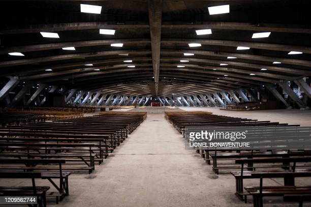Picture shows the empty Saint-Pie-X Basilica in the Sanctuary of Our Lady of Lourdes on April 9 in Lourdes, southwestern France, as the Catholic...