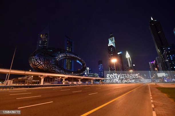 A picture shows the empty Sheikh Zayed road in Dubai on March 27 amid the outbreak of COVID19 The United Arab Emirates of which Dubai is a member has...