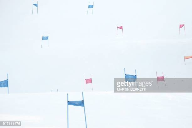 TOPSHOT A picture shows the empty slopes after the Women's Giant Slalom was cancelled because of strong winds at the Jeongseon Alpine Center during...