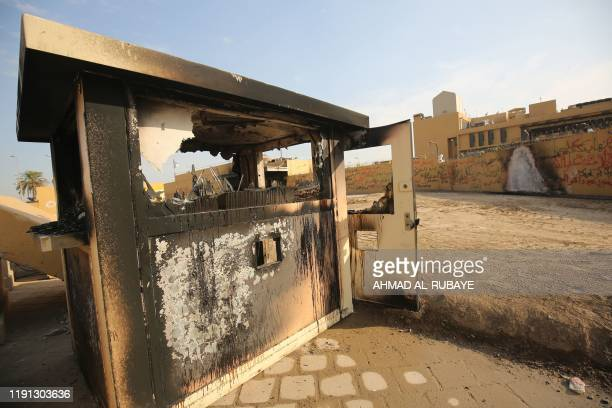 TOPSHOT A picture shows the entrance leading to the US embassy in the capital Baghdad on January 2 which was damaged the day before by Hashed...