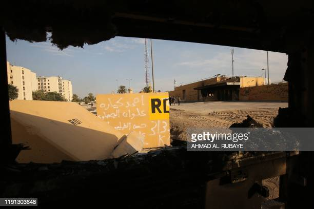 A picture shows the entrance leading to the US embassy in the capital Baghdad on January 2 which was damaged the day before by Hashed supporters The...