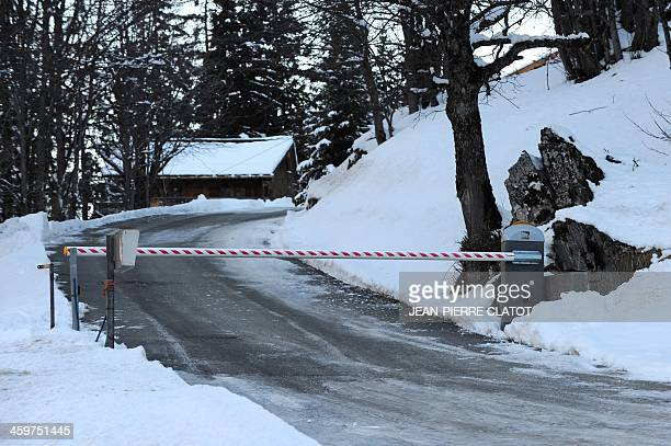 A picture shows the entrance of a private hamlet in the French ski resort of Meribel French Alps on December 30 where German retired Formula One...