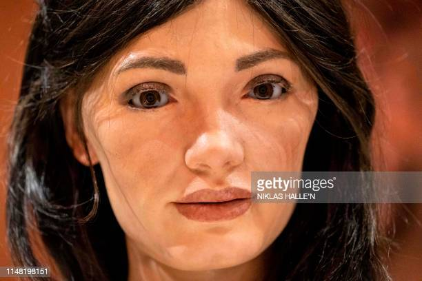 A picture shows the face of AiDa the AI humanoid robot artist during a launch event of its first solo exhibition in Oxford on June 5 2019 AiDa the...