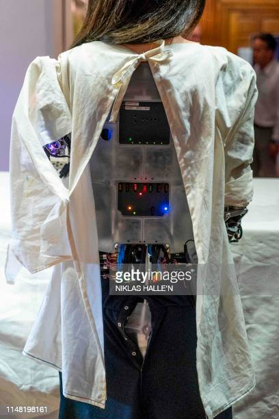 Picture shows the face of Ai-Da the AI humanoid robot artist during a launch event of its first solo exhibition in Oxford on June 5, 2019. - Ai-Da...