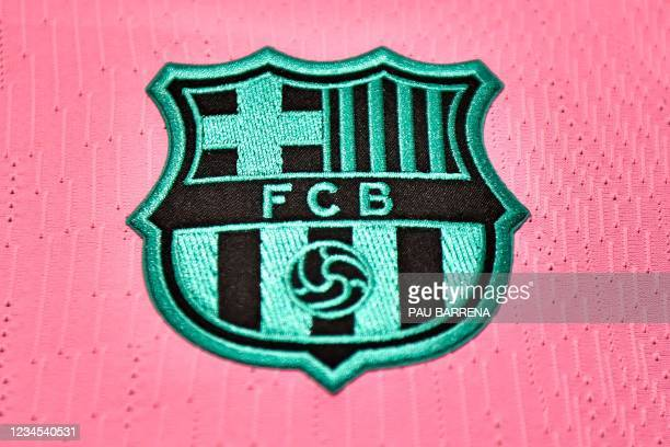 Picture shows the FC Barcelona crest on a football jersey at the official store of the Camp Nou Stadium in Barcelona on August 7, 2021. - News of...