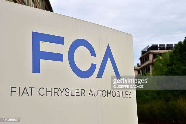 A picture shows the Fiat Chrysler Automobiles logo at the entrance of the headquarters on April 19 2015 in Turin AFP PHOTO / GIUSEPPE CACACE / AFP /...