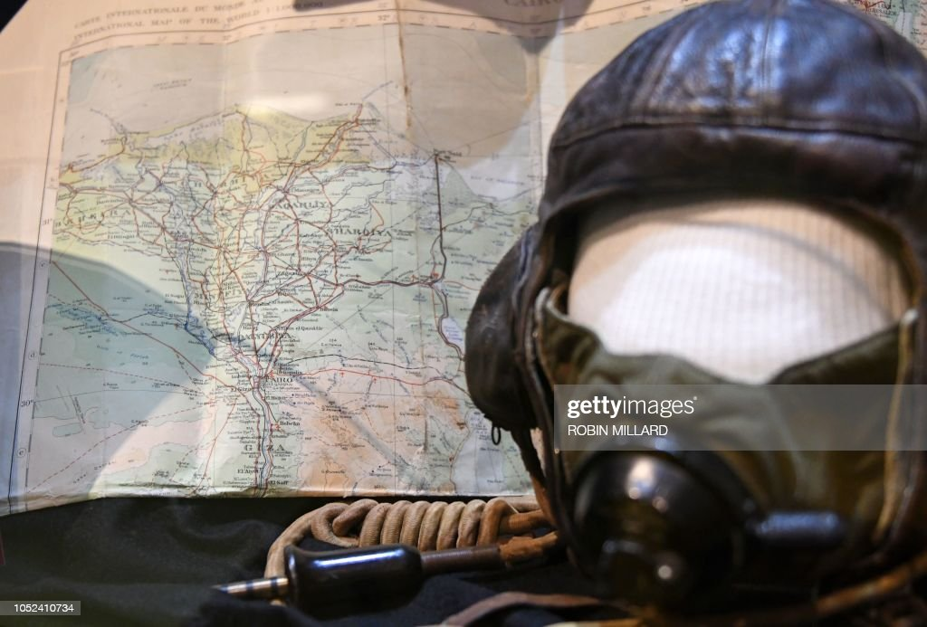A picture shows the flight helmet and map of Egypt owned by author ...