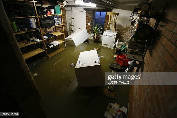 A picture shows the flooded basement of a residential property in York northern England on December 29 2015 Residents in the northern city of York...