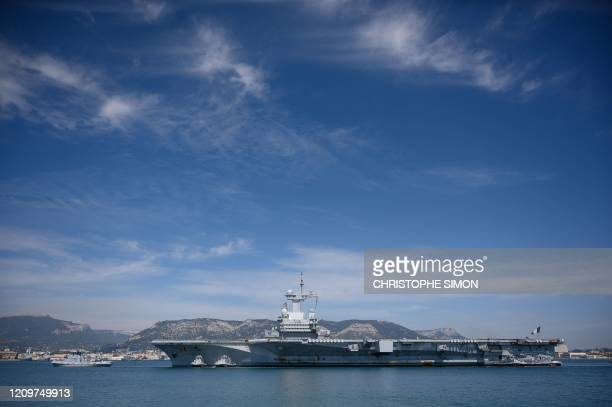 Picture shows the French aircraft carrier Charles de Gaulle on April 12 as it arrives in the southern French port of Toulon with sailors onboard...