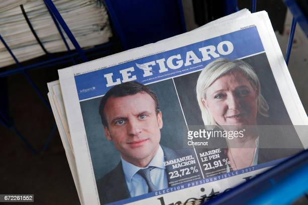A picture shows the front page of the French newspaper 'Le Figaro' with pictures of French Presidential election candidates Emmanuel Macron and...