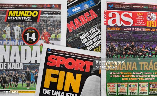 A picture shows the frontpages of Spanish sports newspapers in Madrid on March 6 a day after Ajax beat Real Madrid 41 in the UEFA Champions League...