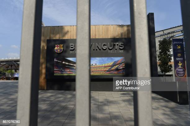 A picture shows the gate of Barcelona FC's Camp Nou stadium which was closed as part of a general strike in Barcelona called by Catalan unions on...