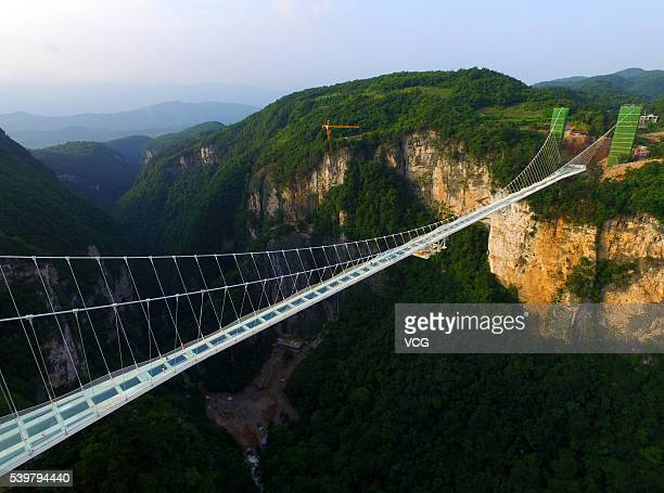 Picture shows the glassbottomed bridge across the Zhangjiajie Grand Canyon on June 12 2016 in Zhangjiajie Hunan Province of China World's longest and...