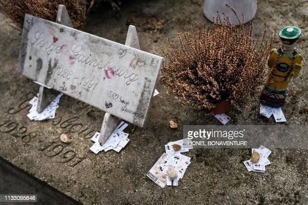 A picture shows the grave of French singersongwriter Serge Gainsbourg at the Montparnasse cemetery in Paris on March 27 2019