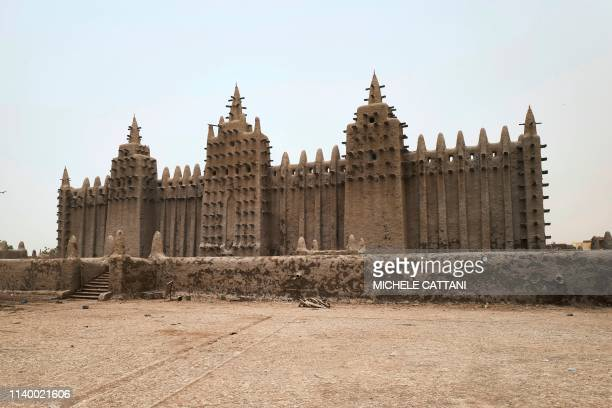 A picture shows the Great Mosque of Djenne in central Mali during its annual rendering ceremony on April 28 2019 Several thousand residents of the...
