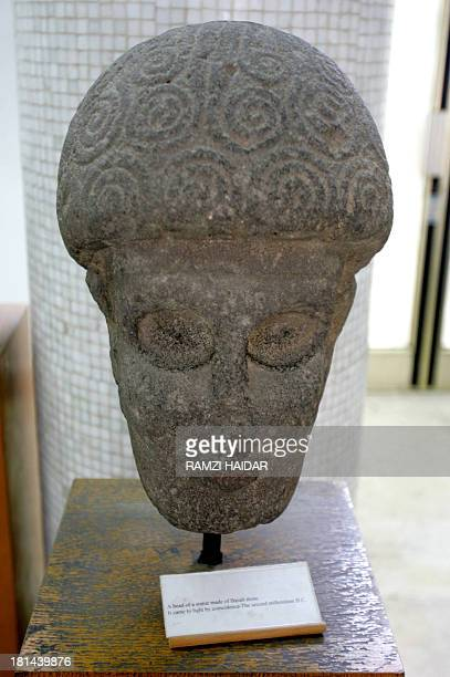 A Picture shows the head of a statue from the second millenium BC made of basalt stone which came to light by coincidence displayed at Aleppo Museum...