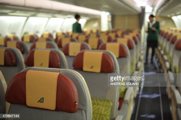 A picture shows the interior of an aircraft airbus A330200 fom airline giant Alitalia following a press conference to present the new brand design...