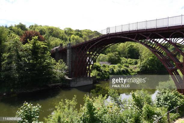 Picture shows The Iron Bridge spanning the River Severn in Ironbridge, Shropshire, West of Brimingham, on May 23, 2019. - The Iron Bridge was built...