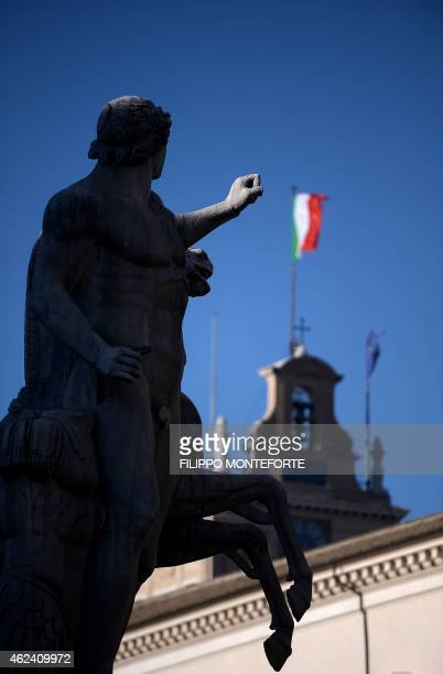 A picture shows the Italian flag on the Palazzo del Quirinale the Italian presidential palace on January 28 2015 in Rome Parliamentarians and...