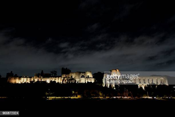 Picture shows the lit up Palatino in Rome on January 3, 2018. - The entire front of the Palatine overlooking the Circus Maximus and all the internal...