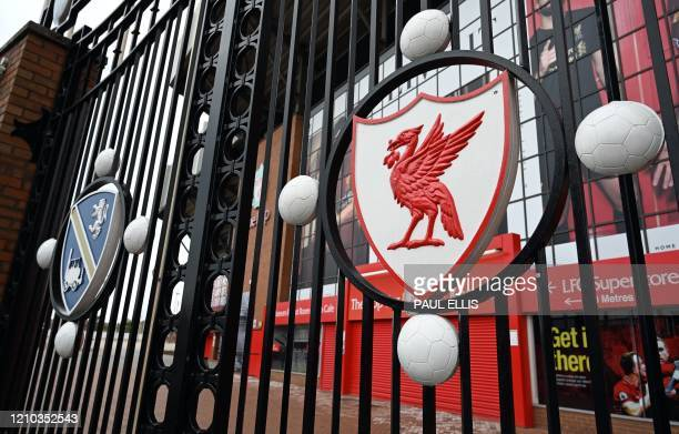 Picture shows the locked gate and emblem at Liverpool football club's stadium Anfield in Liverpool, northwest England, on April 18, 2020. - Premier...