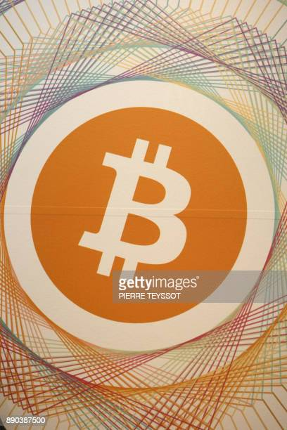 A picture shows the logo Bitcoin in the first Italian Bitcoin crypto currency shop 'Bitcoin Compro Euro' on December 11 2017 in Rovereto northern...
