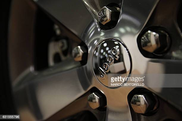 A picture shows the logo of auto maker Jeep from the ItalianAmerican Fiat Chrysler company in a cars dealer on January 12 2017 in Saluzzo near Turin...