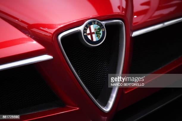 A picture shows the logo of car maker Alfa Romeo on November 29 2017 at the Alfa Romeo Historical Museum in Arese near Milan Alfa Romeo are returning...