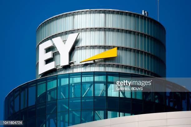 A picture shows the logo of EY a multinational professional services firm in Madrid on September 27 2018