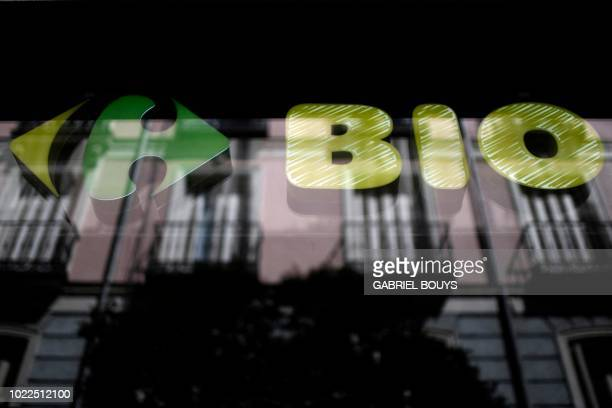 A picture shows the logo of French retail giant Carrefour Bio in Madrid on August 24 2018