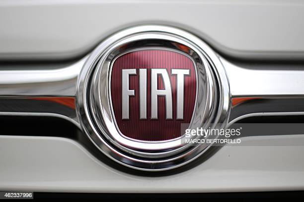A picture shows the logo of Italian auto maker Fiat in piazza San Carlo on January 22 2015 in Turin FiatChrysler said on January 22 2015 it will add...