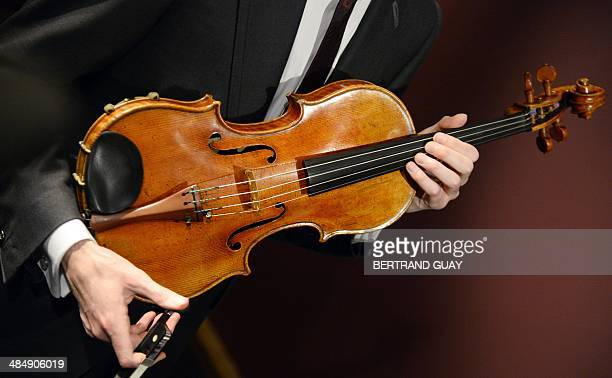 A picture shows the 'Macdonald' Stradivarius viola created in 1719 by Antonio Stradivari at Sotheby's auction house in Paris on April 15 2014...