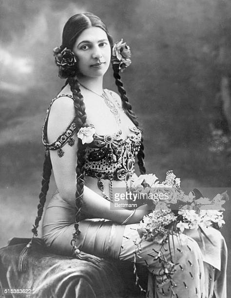 Picture shows the Mata Hari dancer and espionage agent seated with a bouquet of flowers and wearing an elaborate costume Undated photo circa 1910s