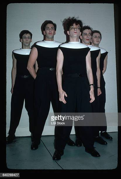 1982 Picture shows the members of the band Devo posing together They are standing in a pyramid style and wearing black outfits with white oval collars